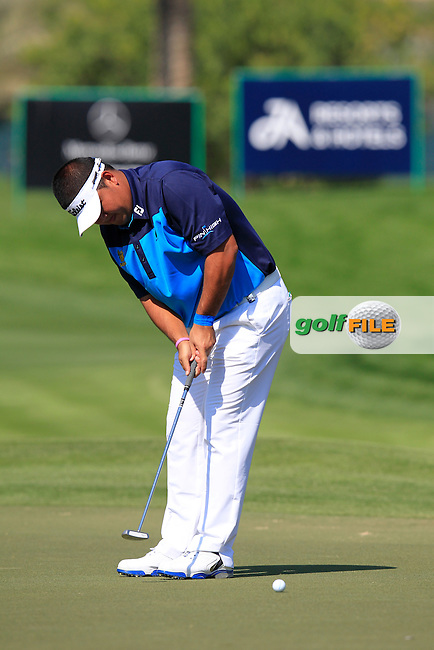 Prom MEESAWAT (THA) putts on the 10th green during Thursday's Round 1 of the 2015 Omega Dubai Desert Classic held at the Emirates Golf Club, Dubai, UAE.: Picture Eoin Clarke, www.golffile.ie: 1/29/2015