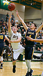 SPEARFISH, SD - JANUARY 8, 2016 -- Wyatt Krogman #11 of Black Hills State drives to the basket against Regis defender Jarrett Brodbeck #4 during their college basketball game Friday at the Donald E. Young Center in Spearfish, S.D. (Photo by Dick Carlson/Inertia)