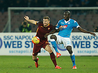 AS Roma's Edin Dzeko  and Napoli's Kalidou Koulibaly  during the  italian serie a soccer match,between SSC Napoli and AS Roma       at  the San  Paolo   stadium in Naples  Italy ,December 13, 2015