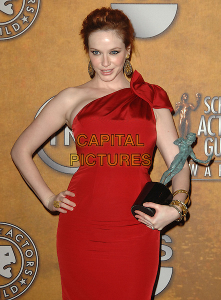 CHRISTINA HENDRICKS .16th Annual Screen Actors Guild Awards - Press Room held at The Shrine Auditorium, Los Angeles, California, USA, 23rd January 2010..SAG SAGs half length red one shoulder dress hand on hip award trophy winner   .CAP/RKE/DVS .©DVS/RockinExposures/Capital Pictures