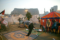 EGYPT / Cairo / A man prays at the sunset in the anti-Morsi protesters' camp, in the middle of Tahrir Square in Cairo.  © Giulia Marchi