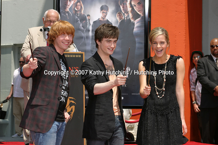 Rupert Grint, Daniel Radcliffe, and Emma Watson.Harry Potter Handprint/Footprint/Wandprint Ceremony.Grauman's Chinese Theater.Los Angeles, CA.July 9, 2007.©2007 Kathy Hutchins / Hutchins Photo...