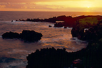 Natural arch at sunrise<br /> Pailoa Bay<br /> Waianapanapa State Park<br /> Island of Maui, Hawaii