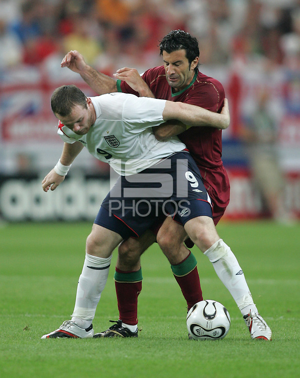 Portuguese forward (7) Luis Figo fights for the ball with English forward (9) Wayne Rooney.  Portugal defeated England on penalty kicks after playing to a 0-0 tie in regulation in their FIFA World Cup quarterfinal match at FIFA World Cup Stadium in Gelsenkirchen, Germany, July 1, 2006.