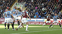 Burnley's Sam Vokes scores the opening goal despite the attentions of Huddersfield Town's Christopher Schindler<br /> <br /> Photographer Rich Linley/CameraSport<br /> <br /> The Premier League - Burnley v Huddersfield Town - Saturday 6th October 2018 - Turf Moor - Burnley<br /> <br /> World Copyright &copy; 2018 CameraSport. All rights reserved. 43 Linden Ave. Countesthorpe. Leicester. England. LE8 5PG - Tel: +44 (0) 116 277 4147 - admin@camerasport.com - www.camerasport.com