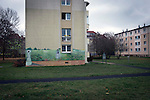 'Housing, Sonnenalle, 2015.' From the series 'Berlin Now and Then (1985-2015)' by photographer Colin McPherson.<br /> <br /> Further caption information:<br /> Blocks of apartments in what was formerly East Berlin, near Sonnenallee, Neukölln. The route of the Wall, which stood from 1961-1989, has been developed into the 'Mauerweg,' a thoroughfare which traces most of the route of the Wall which encircled the city and divided it into East and West Berlin during the Cold War. In the years following the 1989 civil uprising in the German Democratic.Republic, most of the Wall was removed as part of the reunification strategy which united the pro-Soviet DDR and the Federal Republic of (West) Germany.