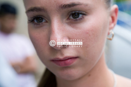 Teenaged girl looking serious,
