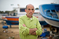 Lampedusa, Marzo 2011. L'inviato de La Stampa Domenico Quirico appena arrivato a Lampedusa dalla Tunisia dopo aver effettuato la traversata a bordo di una delle centinaia di imbarcazioni utilizzate dagli stessi Tunisini per raggiungere illegalmente l'Italia