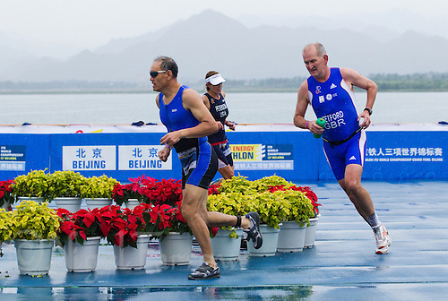 10 SEP 2011 - BEIJING, CHN - John Setford (GBR) (right) - 2011 ITU World Age Group Sprint Distance Triathlon Championships .(PHOTO (C) NIGEL FARROW)