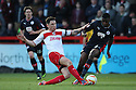 Greg Tansey of Stevenage tackles Hope Akpan of Crawley. Stevenage v Crawley Town - npower League 1 -  Lamex Stadium, Stevenage - 15th December, 2012. © Kevin Coleman 2012..