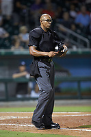 Home plate umpire Jose Navas during the International League game between the Scranton/Wilkes-Barre RailRiders and the Charlotte Knights at BB&T BallPark on August 14, 2019 in Charlotte, North Carolina. The Knights defeated the RailRiders 13-12 in ten innings. (Brian Westerholt/Four Seam Images)