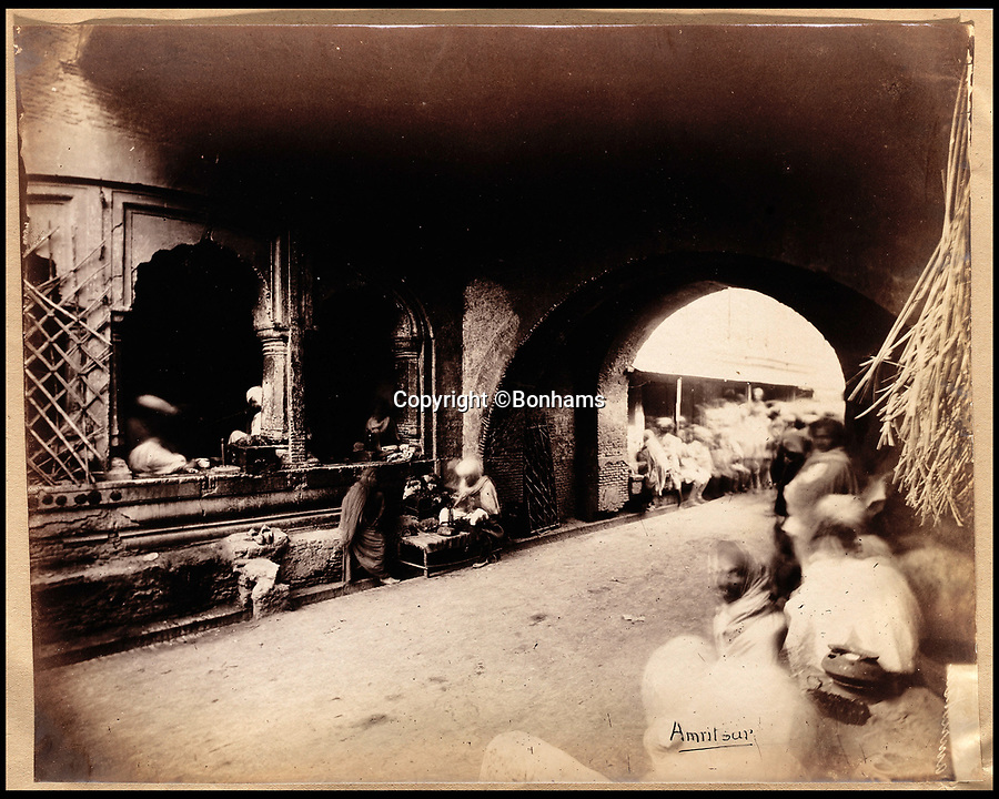 BNPS.co.uk (01202 558833)<br /> Pic: Bonhams/BNPS<br /> <br /> City Gate into Amritsar.<br /> <br /> Plain tales from the Punjab - unseen archive of Indian photographs compiled by Rudyard Kiplings father revealed.<br /> <br /> A remarkable photo album compiled by John Lockwood Kipling documenting his time in Northern India in the late 19th century has emerged for sale for £150,000.<br /> <br /> Lockwood, father of the celebrated writer Rudyard, lived in India between 1865 and 1893.<br /> <br /> An acclaimed artist in his own right, he took numerous eye-catching snaps of glorious monuments and bustling street scenes around Lahore, the Punjab and Amritsar.<br /> <br /> The photos date from around 1888, when he was working at the Mayo Art school in Lahore and as curator at the Lahore Museum.<br /> <br /> At that time his son Rudyard was a little known cub reporter for the Pioneer newspaper in Allahabad ,who was just about to publish 'Plain tales from the Hills', launching his literary career.
