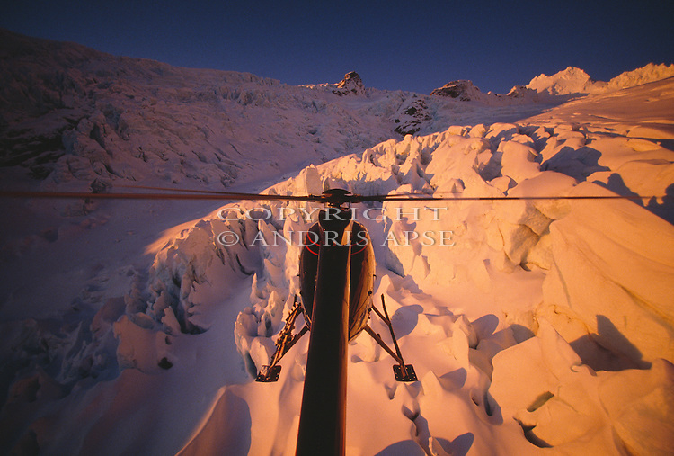 Hughes 500 D Helicopter above Mount Whitcombe at sunset in Canterbury New Zealand