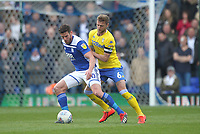 Leeds United's Liam Cooper battles with  Birmingham City's Gary Gardner <br /> <br /> Photographer Mick Walker/CameraSport<br /> <br /> The EFL Sky Bet Championship - Birmingham City v Leeds United - Saturday 6th April 2019 - St Andrew's - Birmingham<br /> <br /> World Copyright © 2019 CameraSport. All rights reserved. 43 Linden Ave. Countesthorpe. Leicester. England. LE8 5PG - Tel: +44 (0) 116 277 4147 - admin@camerasport.com - www.camerasport.com