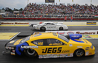 May 11, 2013; Commerce, GA, USA: NHRA pro stock driver Jeg Coughlin Jr (near) alongside Shane Gray during the Southern Nationals at Atlanta Dragway. Mandatory Credit: Mark J. Rebilas-