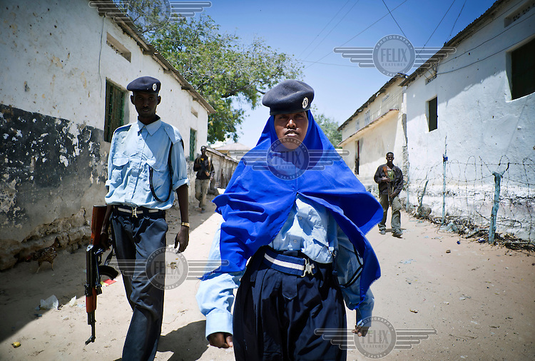 Policewoman Khadija Haji Diriye investigates local complaints with a colleague in Mogadishu.