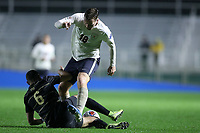 CARY, NC - DECEMBER 13: Justyn Thomas #6 of Wake Forest University tackles the ball away from Axel Gunnarsson #18 of University of Virginia during a game between Wake Forest and Virginia at Sahlen's Stadium at WakeMed Soccer Park on December 13, 2019 in Cary, North Carolina.