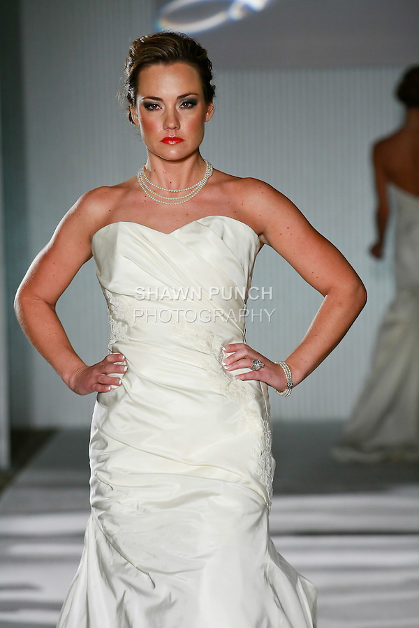 Model walks the runway in a Valena Valentina Couture wedding dress by Elena Ham, during the Wedding Trendspot Spring 2011 Press Fashion, October 17, 2010.