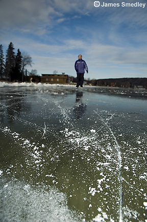 Children skating on a frozen lake in winter