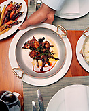 USA, California, Los Angeles, top view of dishes and table at Craft Restaurant.