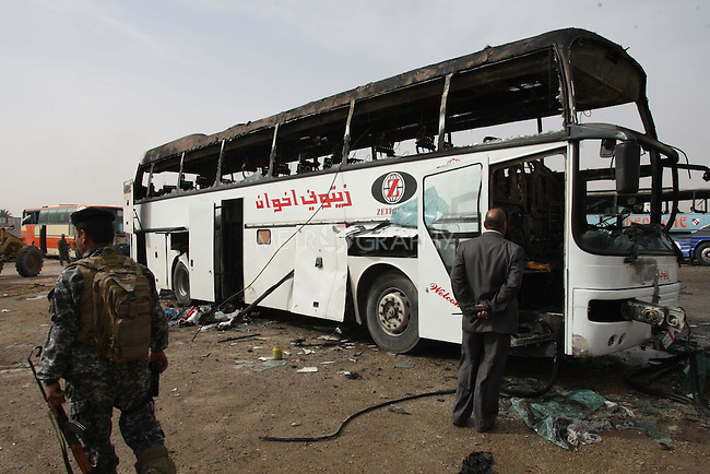 NAJAFA, IRAQ: Machinary removes the remains of a car...A car bomb in Iraq's holy city of Najaf has killed at least three people and wounded 50 on the eve of tense parliamentary elections