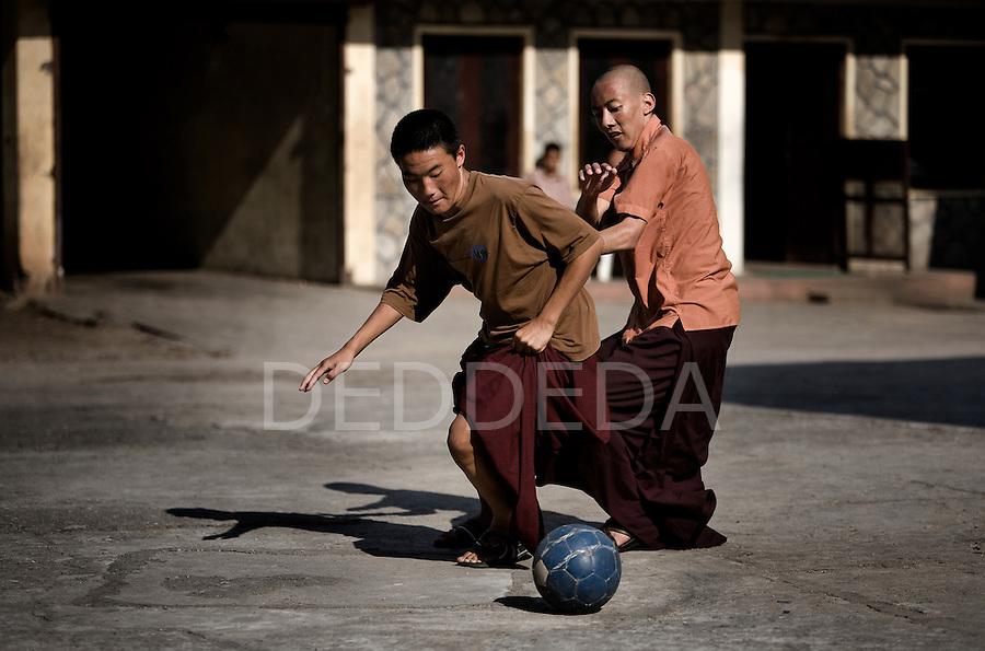 Two monks play soccer at a monastary near Pokhara, Nepal.