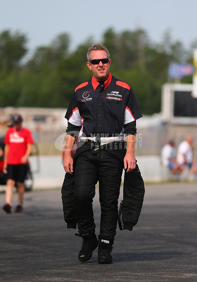 Aug. 18, 2013; Brainerd, MN, USA: NHRA top fuel dragster driver Tommy Johnson Jr during the Lucas Oil Nationals at Brainerd International Raceway. Mandatory Credit: Mark J. Rebilas-