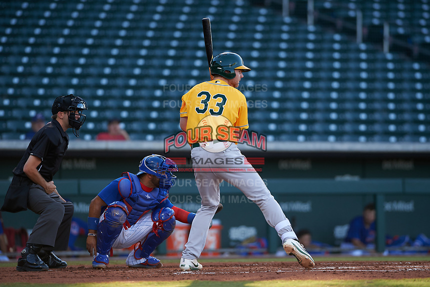 AZL Athletics Gold Kyle McCann (33) at bat  in front of umpire Cas Cousins and catcher Richard Nunez (5) during an Arizona League game against the AZL Cubs 1 at Sloan Park on June 20, 2019 in Mesa, Arizona. AZL Athletics Gold defeated AZL Cubs 1 21-3. (Zachary Lucy/Four Seam Images)