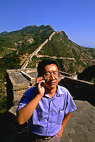 Chinese man with a cell phone on the great Wall of China