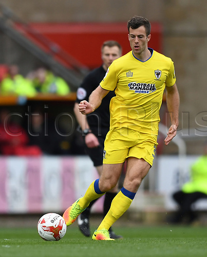 April 14th 2017, County Ground, Swindon, Wiltshire; Skybet league 1 football, Swindon Town versus AFC Wimbledon; Jonathan Meades, defender AFC Wimbledon plays the ball through