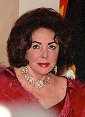 Elizabeth Taylor waits in the receiving line at the Creator' Dinner at the White House in Washington, D.C. to be greeted by the Clintons on 31 December, 1999.<br /> Credit: Ron Sachs / CNP