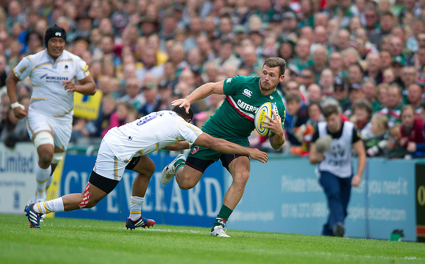 Leicester Tigers' Adam Thompstone is tackled by Worcester Warriors' Jeremy Su'a <br /> <br /> Photo by Stephen White/CameraSport<br /> <br /> Rugby Union - Aviva Premiership - Leicester Tigers v Worcester Warriors - Sunday 8th September 2013 - Welford Road - Leicester<br /> <br /> &copy; CameraSport - 43 Linden Ave. Countesthorpe. Leicester. England. LE8 5PG - Tel: +44 (0) 116 277 4147 - admin@camerasport.com - www.camerasport.com