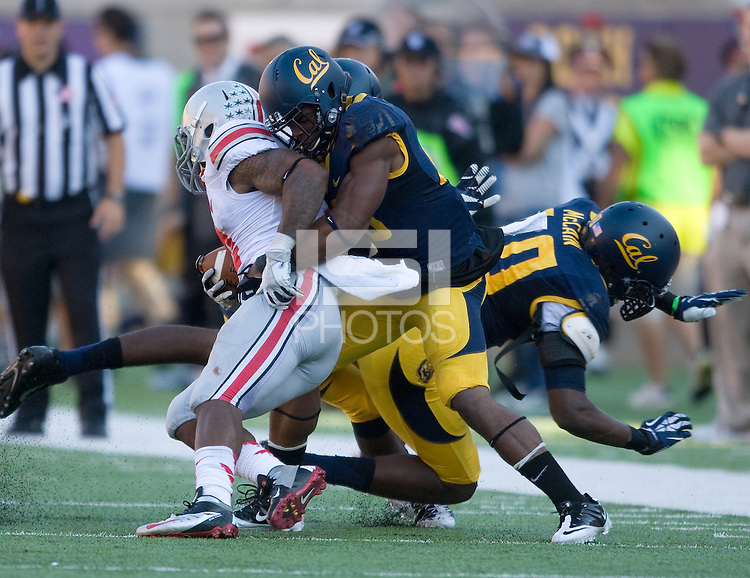Joel Willis of California tackles Ohio State half back Jordan Hall during the game at Memorial Stadium in Berkeley, California on September 14th, 2013.  Ohio State defeated California, 52-34.