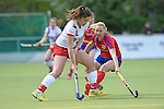 Mannheim, Germany, April 18: During the 1. Bundesliga Damen match between TSV Mannheim (white) and Mannheimer HC (red) on April 18, 2015 at TSV Mannheim in Mannheim, Germany. Final score 1-7 (1-4). (Photo by Dirk Markgraf / www.265-images.com) *** Local caption *** Lea Goerdt #27 of TSV Mannheim, Bara Haklova #24 of Mannheimer HC