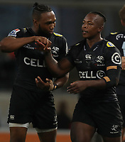 DURBAN, SOUTH AFRICA - MAY 05: Lukhanyo Am with S'busiso Nkosi of the Cell C Sharks after his try during the Super Rugby match between Cell C Sharks and Highlanders at Jonsson Kings Park Stadium in Durban, South Africa on Saturday, 5 May 2018. Photo: Steve Haag / stevehaagsports.com
