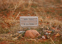 "A grave marker reads ""baby girl"" in a cemetery for children in the polygamous FLDS community of Hildale, Utah."