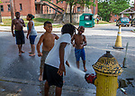 WATERBURY,  CT-071919JS13--  Children cool off after firefighters opened a fire hydrant in Berkeley Heights to on oppressively hot Saturday afternoon during a block party. The hydrant was opened by members of Waterbury Fire Department Engine 7 on Walnut Street. <br /> Jim Shannon Republican American