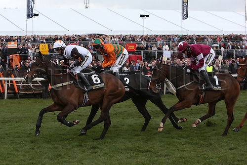 09.04.2016. Aintree, Liverpool, England. Crabbies Grand National Festival Day 3. Ubak ridden by Joshua Moore leads the Gaskell's Waste Management Handicap Hurdle from Rock the Kasbah ridden by Richard Johnson and Sisal ridden by Jack Sherwood.