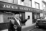 Jackie Healy-Rae ponders a pint outside his pub in 1990.<br />