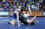SIOUX FALLS, SD - NOVEMBER 15: Zach Price from South Dakota State rolls Zach Trampe from Binghamton to his back during their 133 pound match Friday night at the Sanford Pentagon in Sioux Falls, SD. (Photo by Dave Eggen/Inertia)