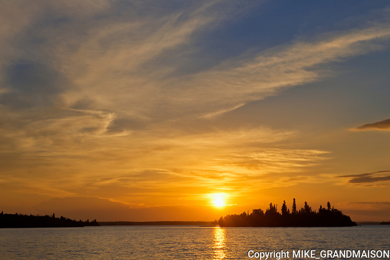Island in Lac Seul (English River) at sunrise<br />