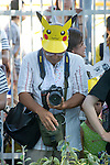 An amateur photographer checks his images during the Pikachu Parade on August 7, 2016. It was held during the weeklong Pikachu Breakout event in the Japanese port town of Yokohama, nearby Tokyo.<br /> <br /> Photo by DUITS/AFLO