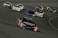 Aug 30, 2008; Fontana, CA, USA; NASCAR Nationwide Series driver Kyle Busch leads the field during the Camping World 300 at Auto Club Speedway. Mandatory Credit: Mark J. Rebilas-