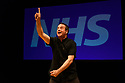 """Edinburgh, UK. 29.07.2018. Lakin McCarthy, in association with Nick of Time Productions Ltd, presents """"Check Up: Our NHS at 70"""", by Mark Thomas, at the Traverse Theatre, as part of the Edinburgh Festival Fringe. Directed Nicolas Kent. with set, lighting and video design by Jon Driscoll. Picture shows: Mark Thomas. Photograph © Jane Hobson."""