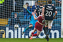 Dundee's David Clarkson scores their late winning goal.
