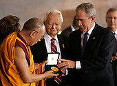 U.S. President George W. Bush (R) and U.S. Senator Robert Byrd present the Dalai Lama with the Congressional Gold Medal in Washington DC USA on 17 October 2007. U.S. President George W. Bush (R) and U.S. Senator Robert Byrd present the Dalai Lama with the Congressional Gold Medal in Washington DC USA on 17 October 2007.