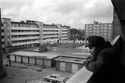 Woman alone on walk way balcony of her tower block of flats Hoxton east London 1978.<br /> <br /> My ref 31/3521/. 1978,