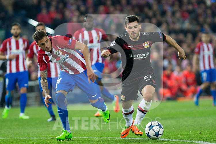 Jose Maria Gimenez of Atletico de Madrid competes for the ball with Kevin Volland of Bayer 04 Leverkusen during the match of Uefa Champions League between Atletico de Madrid and Bayer Leverkusen at Vicente Calderon Stadium  in Madrid, Spain. March 15, 2017. (ALTERPHOTOS / Rodrigo Jimenez)
