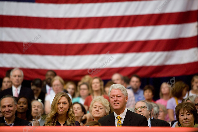 Former President Bill Clinton, accompanied by his daughter, Chelsea, looks on as his wife, Senator Hillary Clinton (D-NY), concedes the nomination contest to Senator Barak Obama (D-IL) during a speech to her supporters at the National Building Museum. Washington, D.C., June 7, 2008.