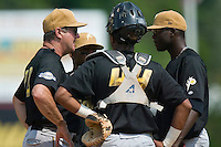 West Virginia pitching coach John Curtis chats with his starting pitcher Roque Mercedes (47) and catcher Martin Maldonado (44) at Fieldcrest Cannon Stadium in Kannapolis, NC, Wednesday, May 30, 2007.